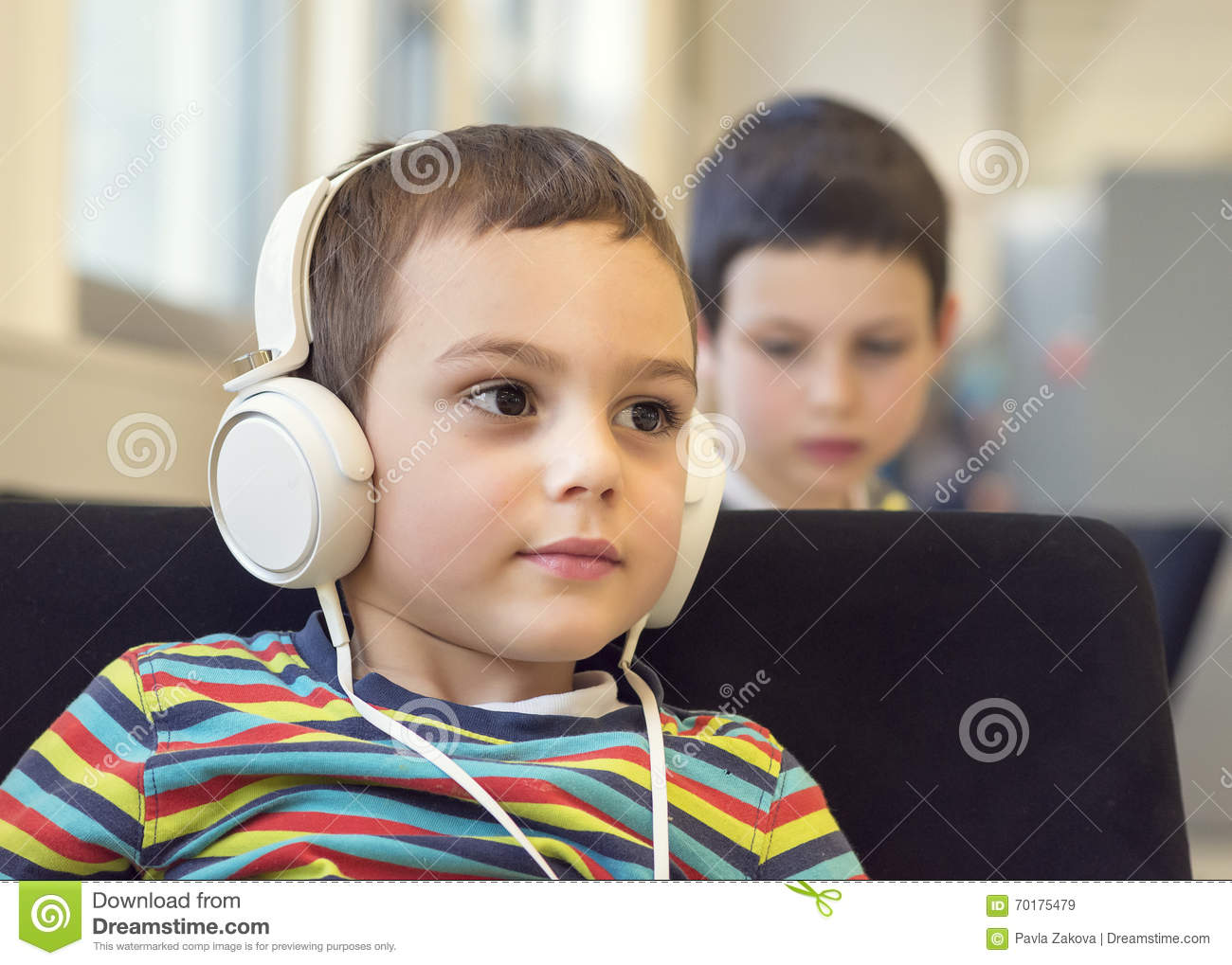 Child With Headphones In School Or Library Stock Image Image Of