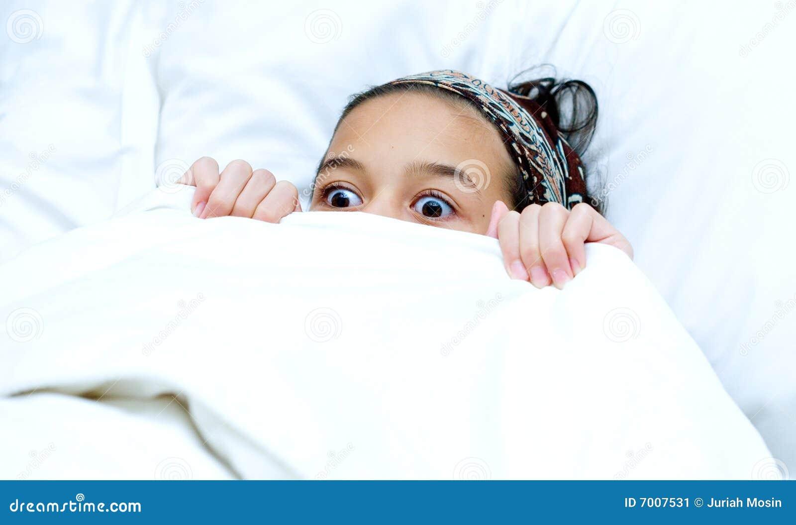 Child Hiding Behind Bl...