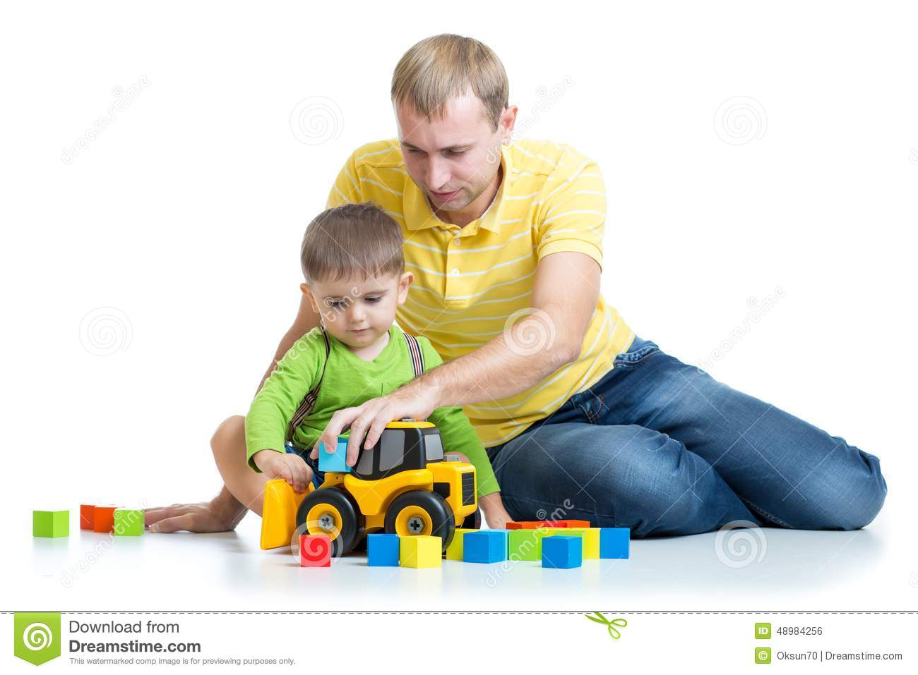 Toys For Dads : Child and his dad repair toy tractor stock photo image
