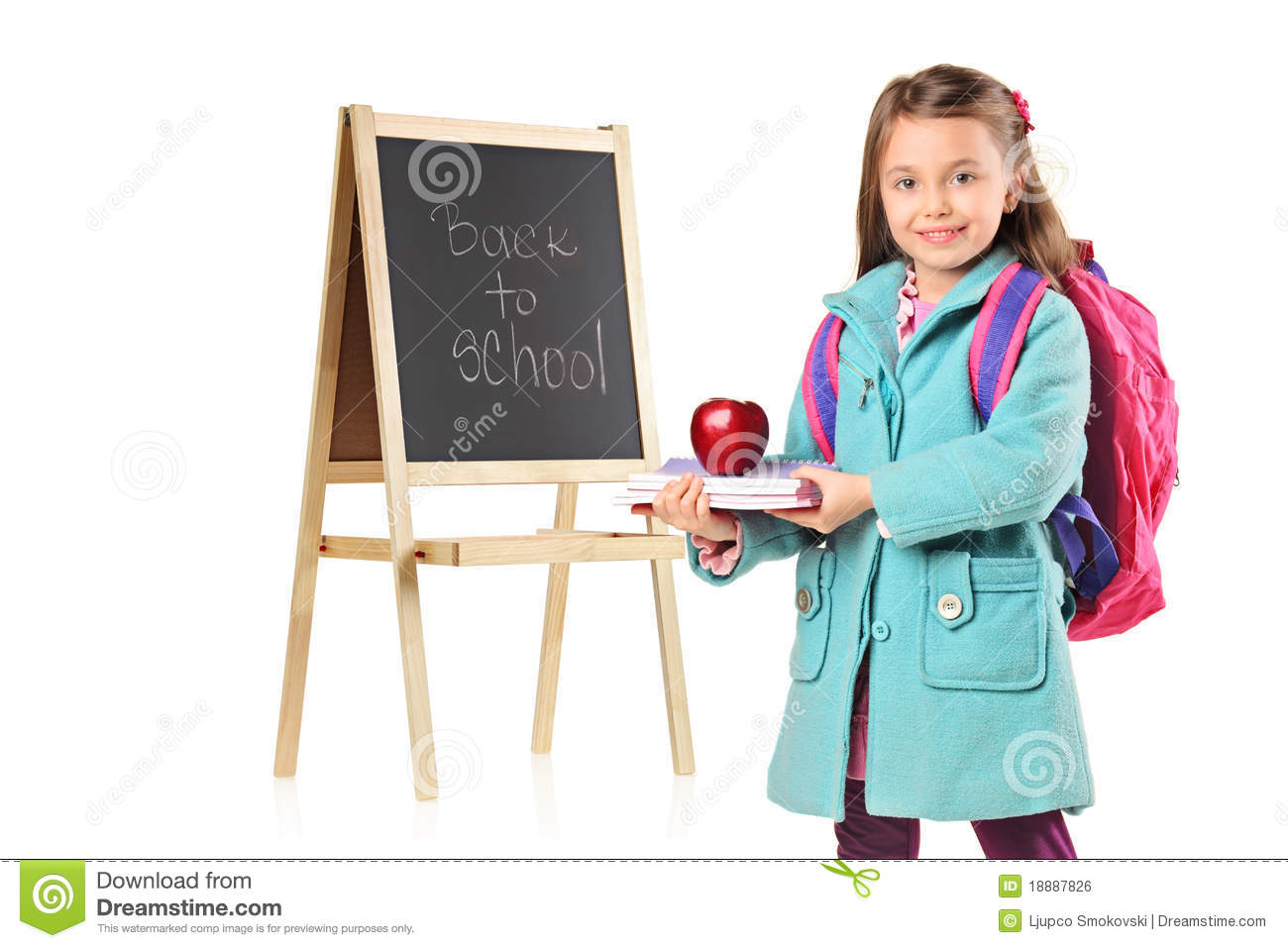 4a61c675de09 A child next to a school board holding books and red apple isolated on white  background