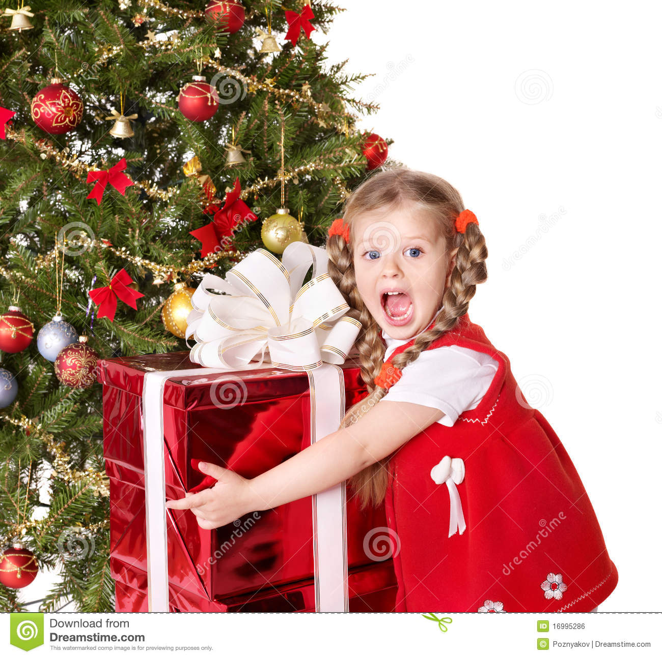 Child Holding Gift Box By Christmas Tree. Royalty Free Stock Image ...