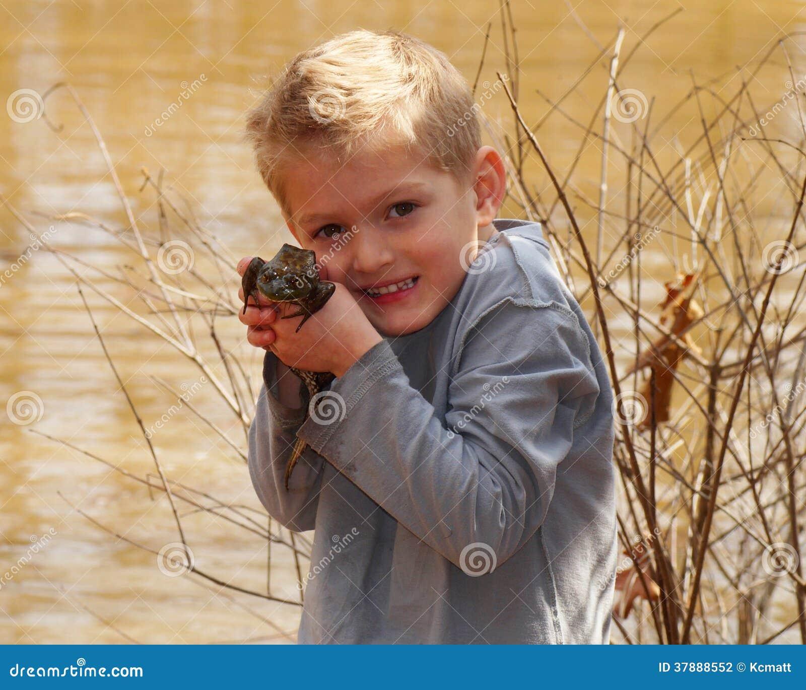 Child holding a large bullfrog