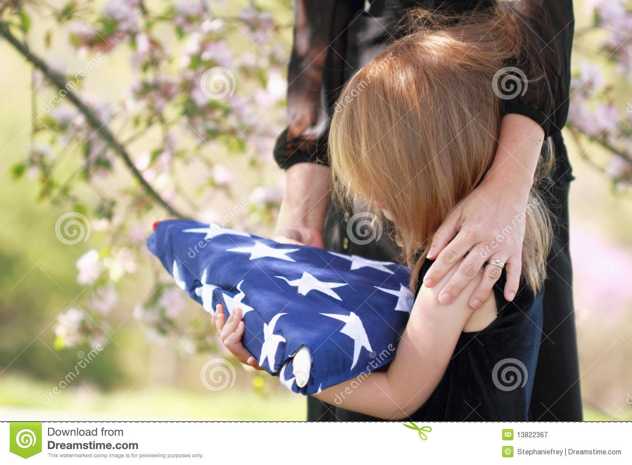 Child Holding a Parent s Folded American Flag