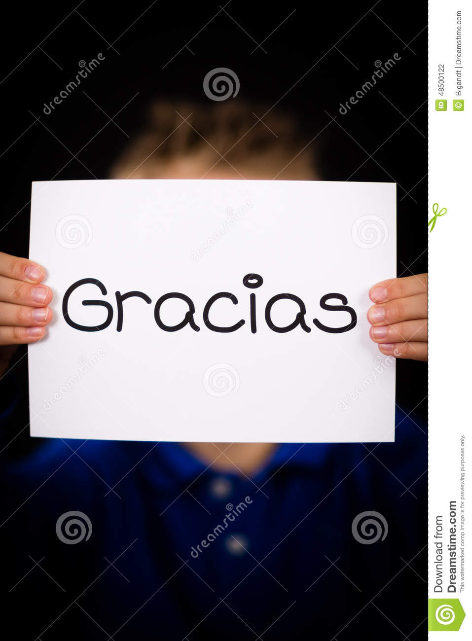 child holding sign with spanish word gracias - thank you stock photo