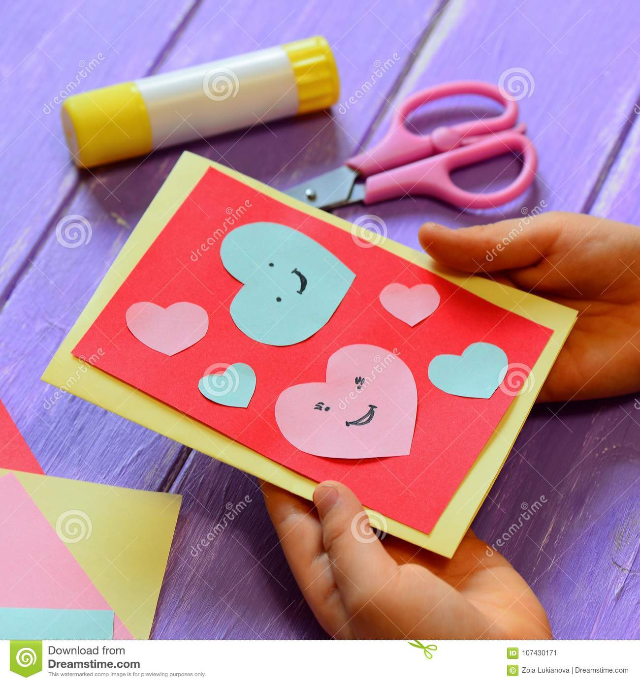 Child Is Holding A Valentines Day Greeting Card In His Hands Small