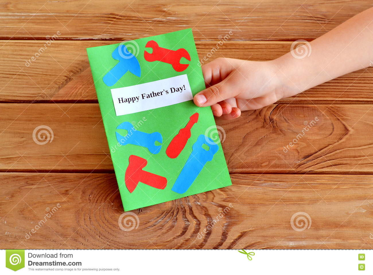 Child holds a card in hand greeting card fathers day happy greeting card with paper tools happy fathers day fathers day gift fathers day greeting card m4hsunfo