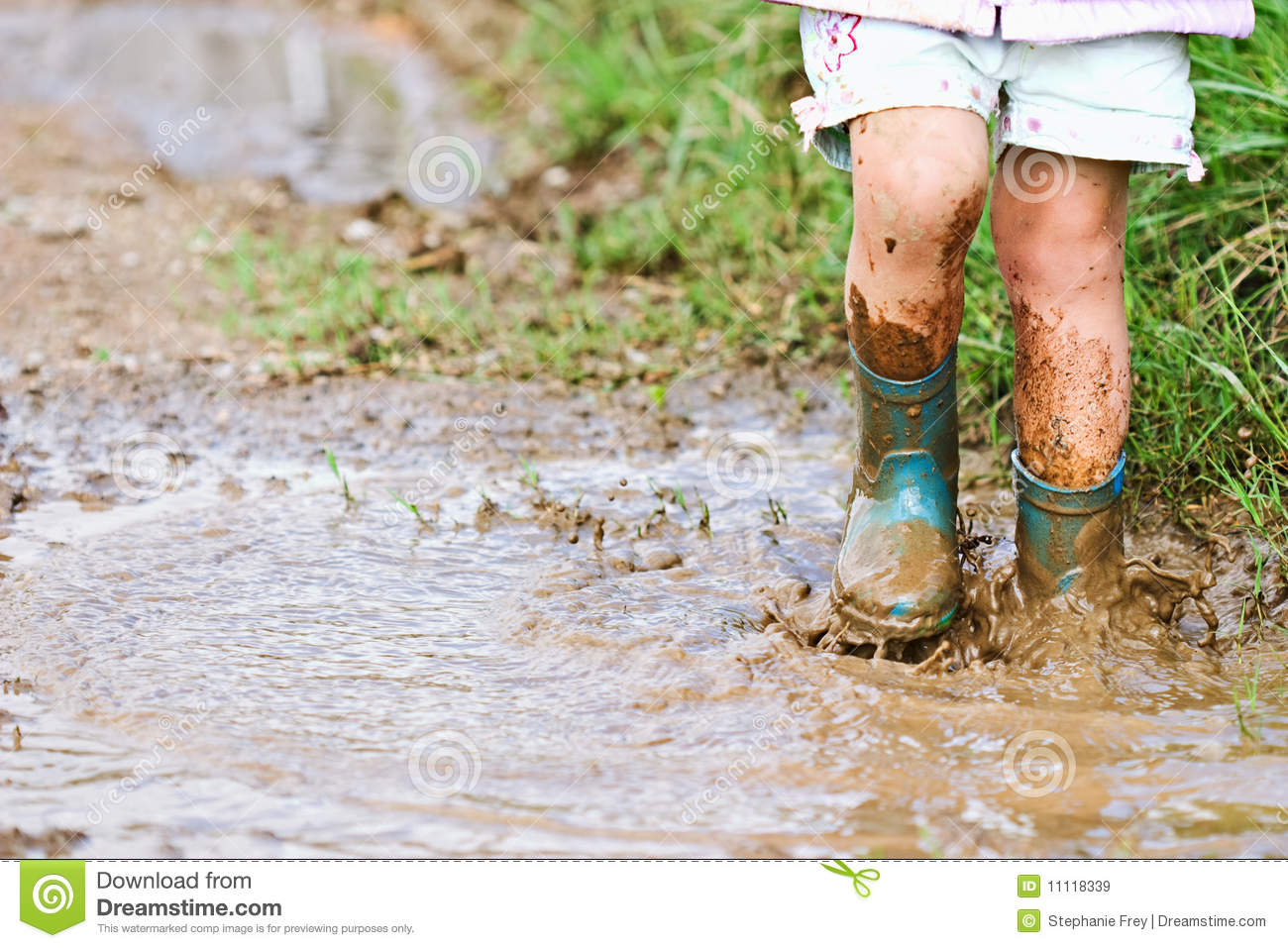 child jumping in mud puddle stock image image of boots person 11118339. Black Bedroom Furniture Sets. Home Design Ideas