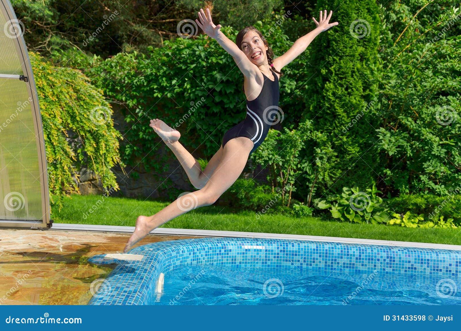 Child jumps to swimmimg pool stock photo image of - Swimming pool girl christmas vacation ...