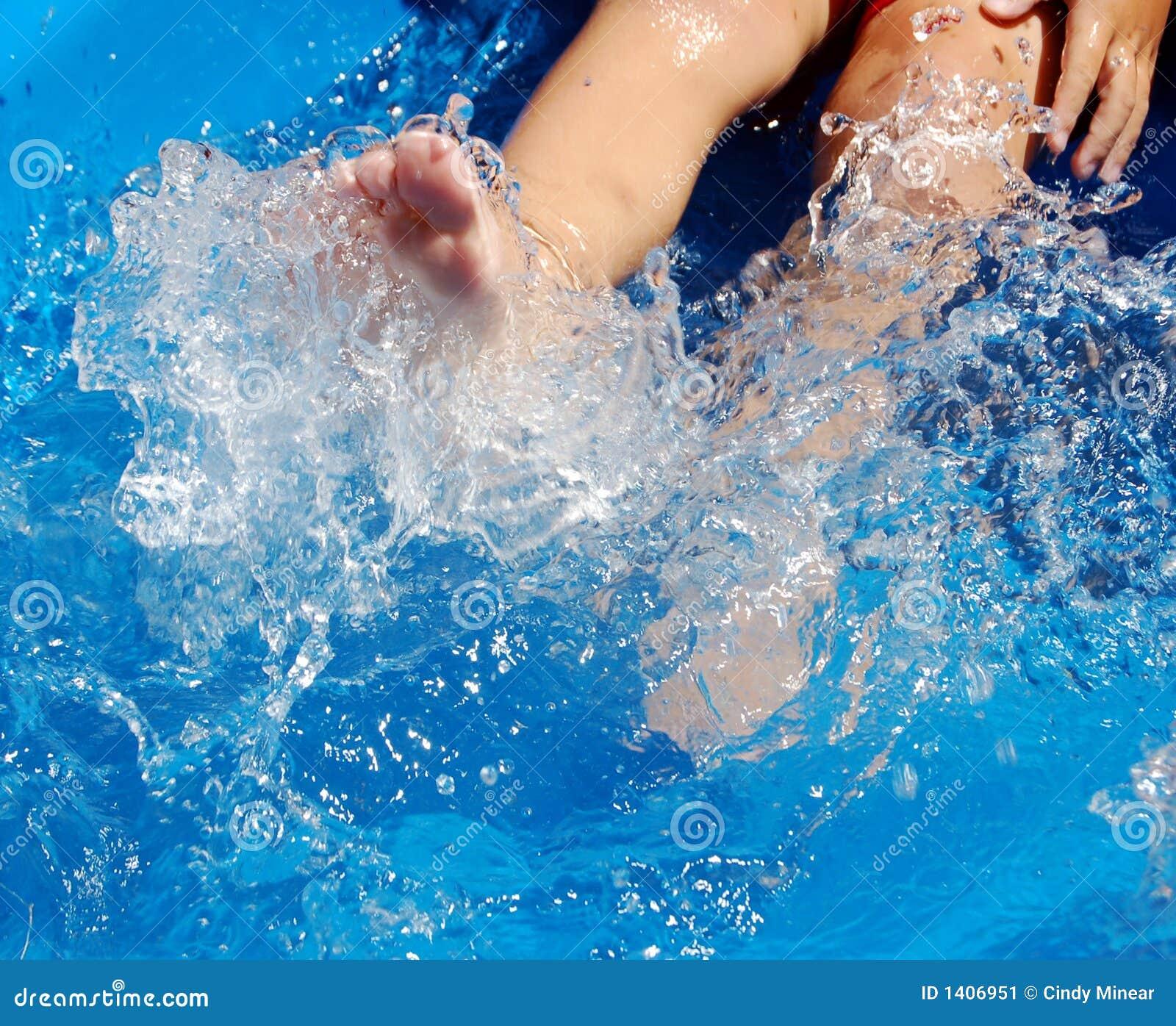 Pool Water Splash child splashing water feet pool stock photos, images, & pictures