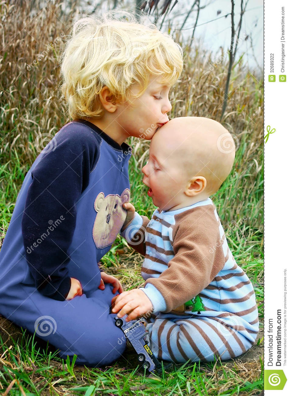 Child Kissing Baby Brother Stock Photo Image Of Together