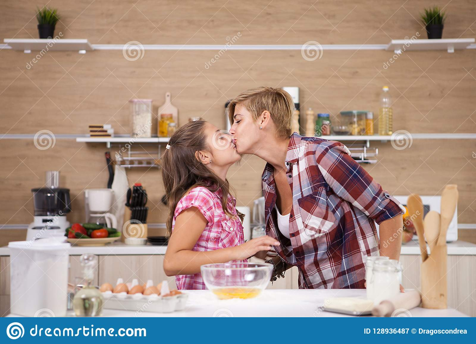 Child leping mother prepare delicious food for both of them
