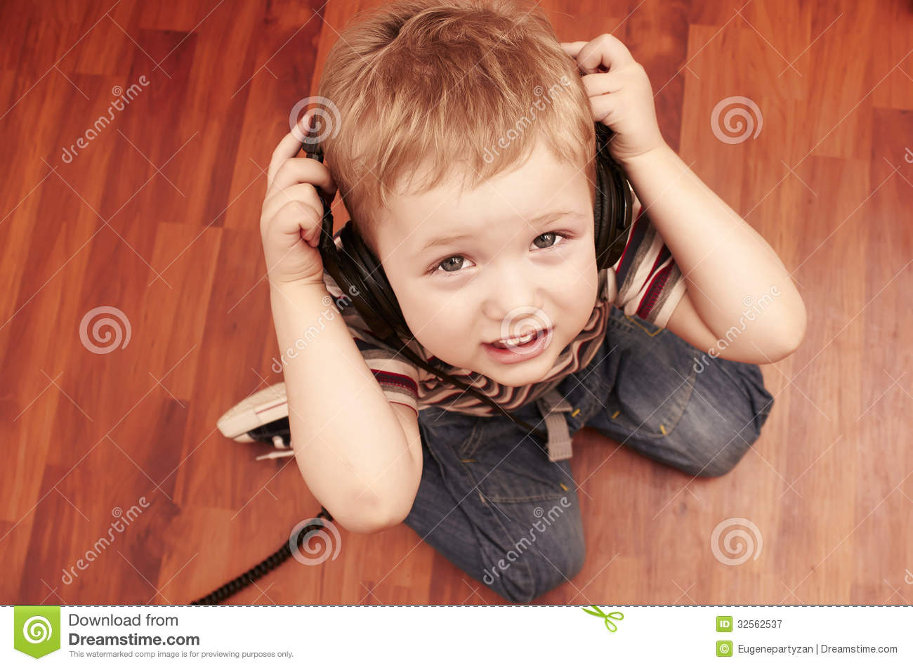 Royalty free stock photography child listening a music in headphones
