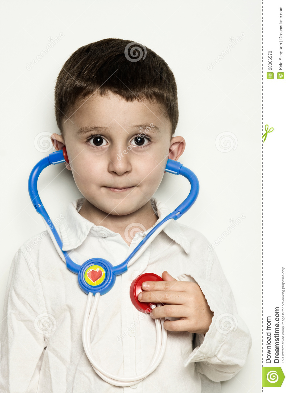 Child Listening To Heartbeat With A Stethoscope Stock