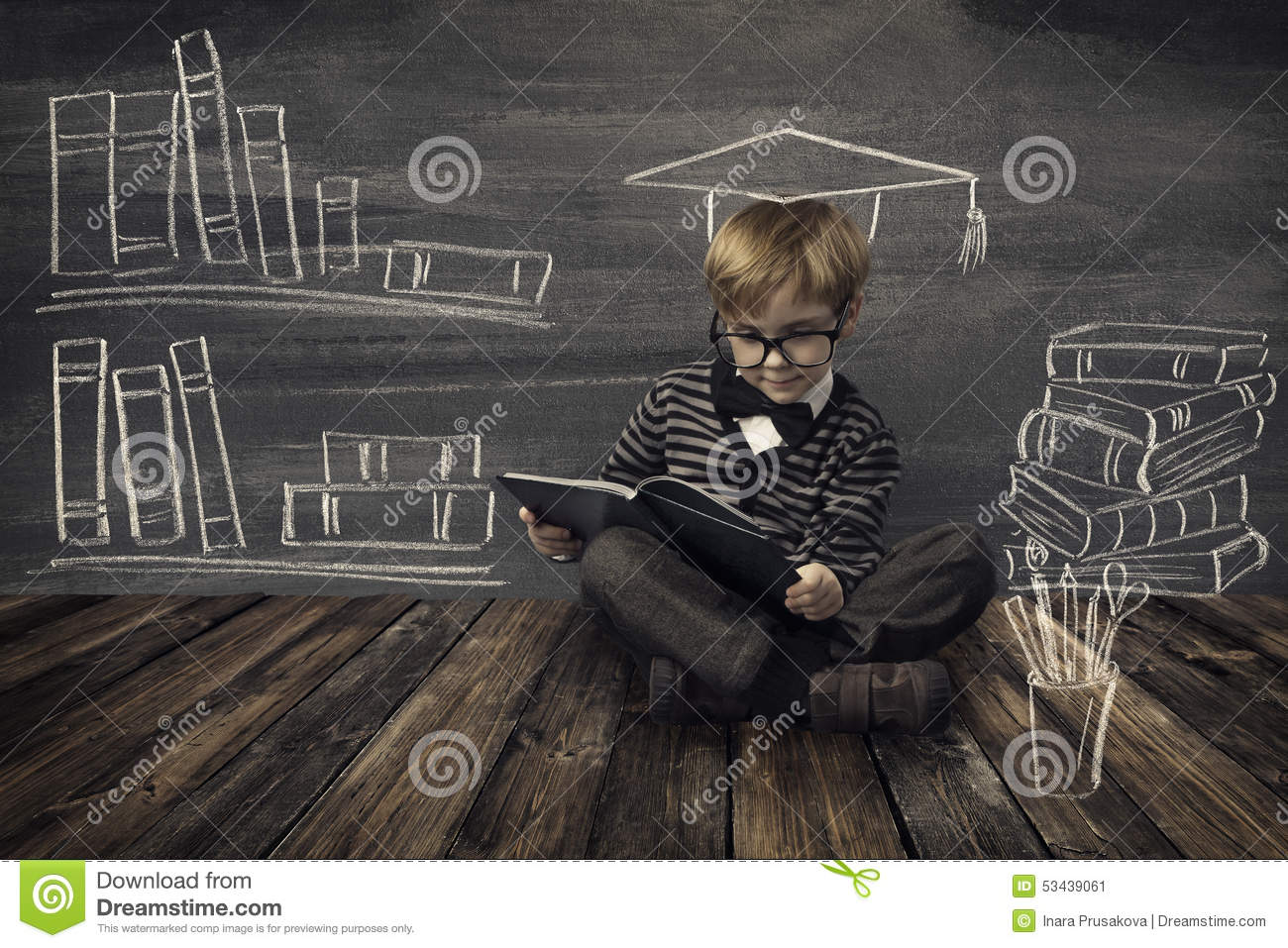Child Little Boy in Glasses Reading Book over School Black Board