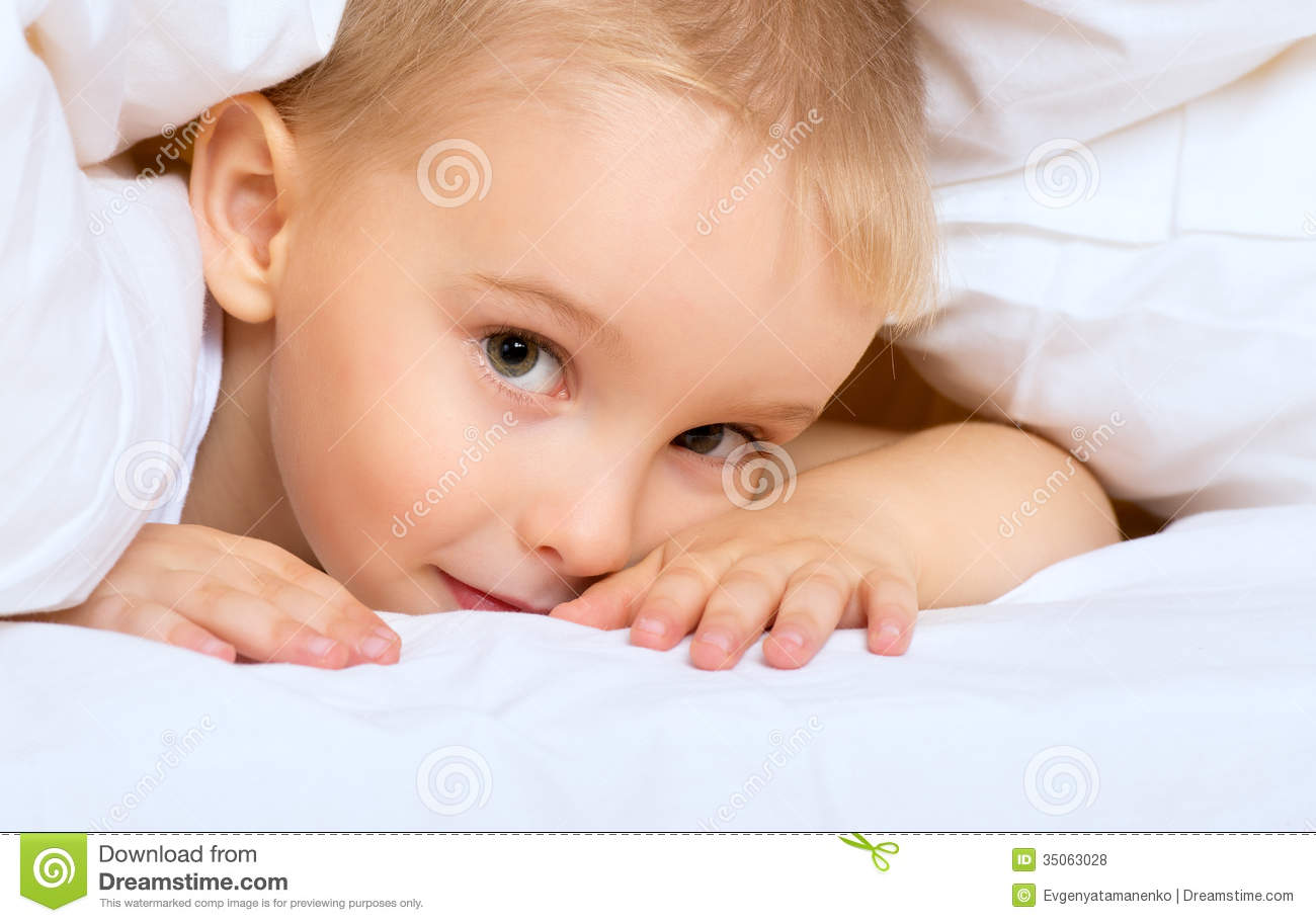 Child Little Boy Is Lying In Bed Under Blanket Royalty