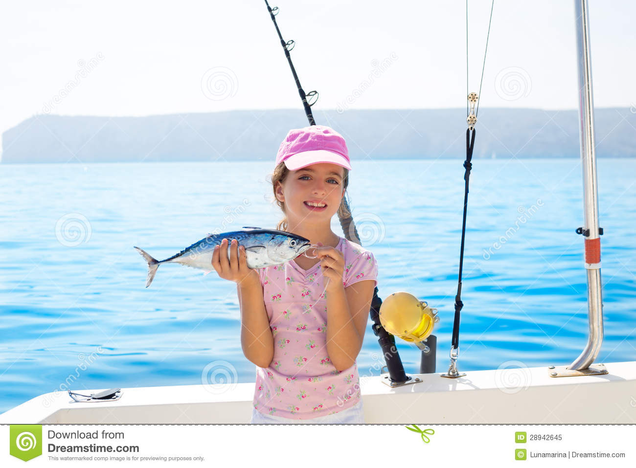 Child little girl fishing in boat holding little tunny for Fishing for girls