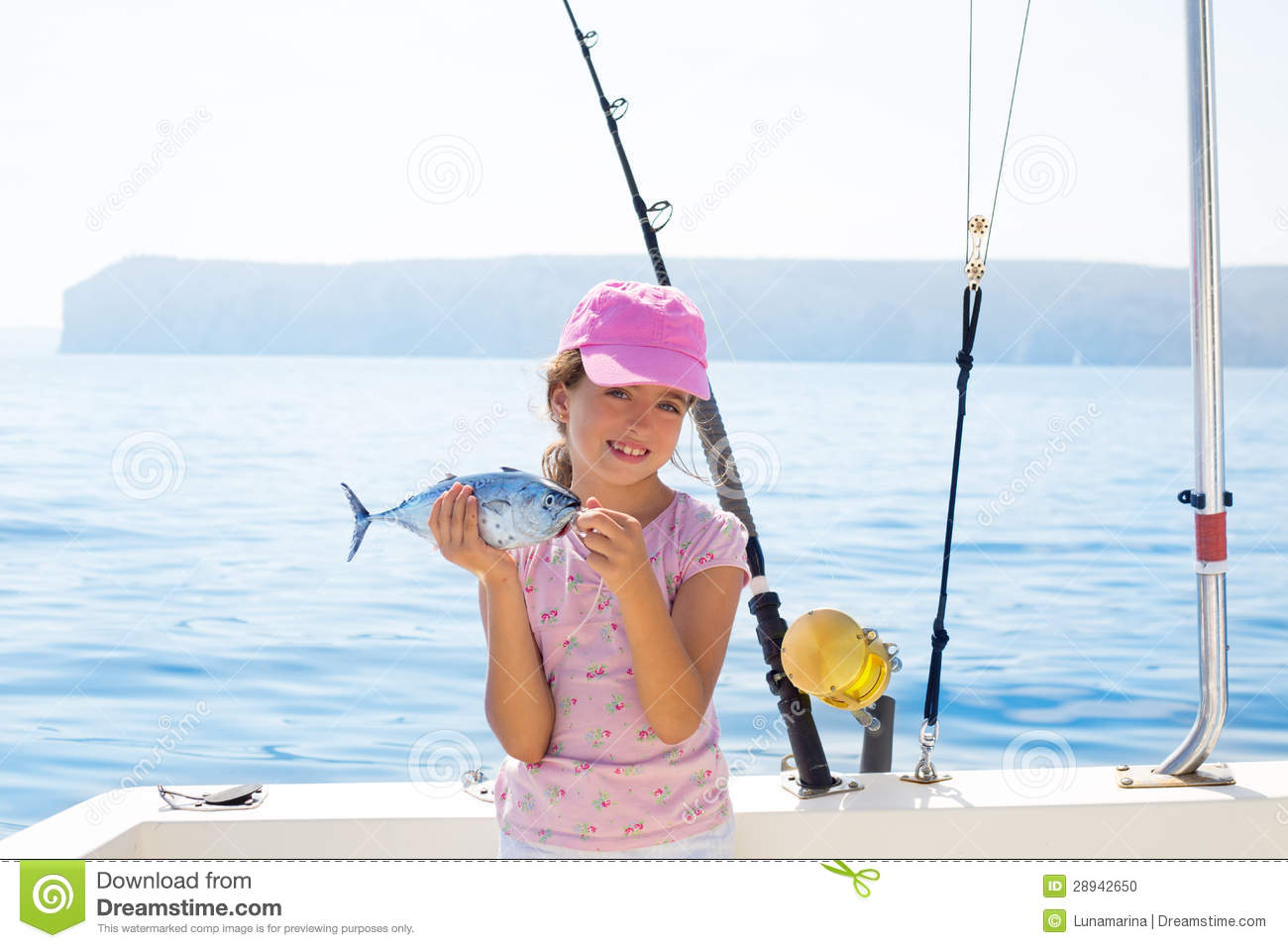 Child Little Girl Fishing In Boat Holding Little Tunny Fish Catc Stock ...