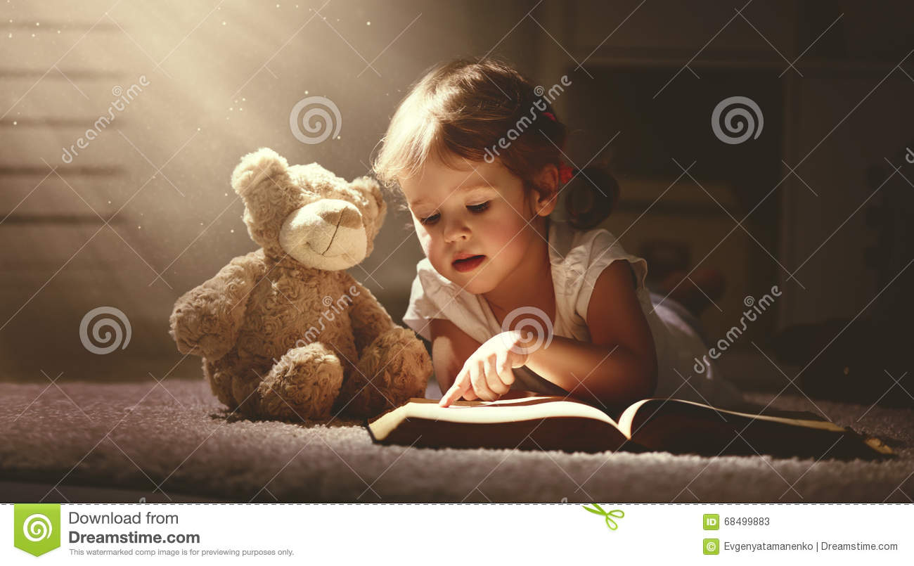 Download Child Little Girl Reading A Magic Book In Dark Home Stock Image - Image of caucasian, female: 68499883
