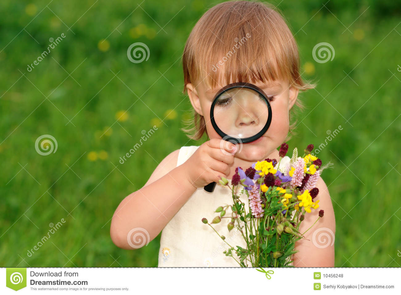 Child Looking At Flowers Through Magnifying Glass Royalty Free Stock s