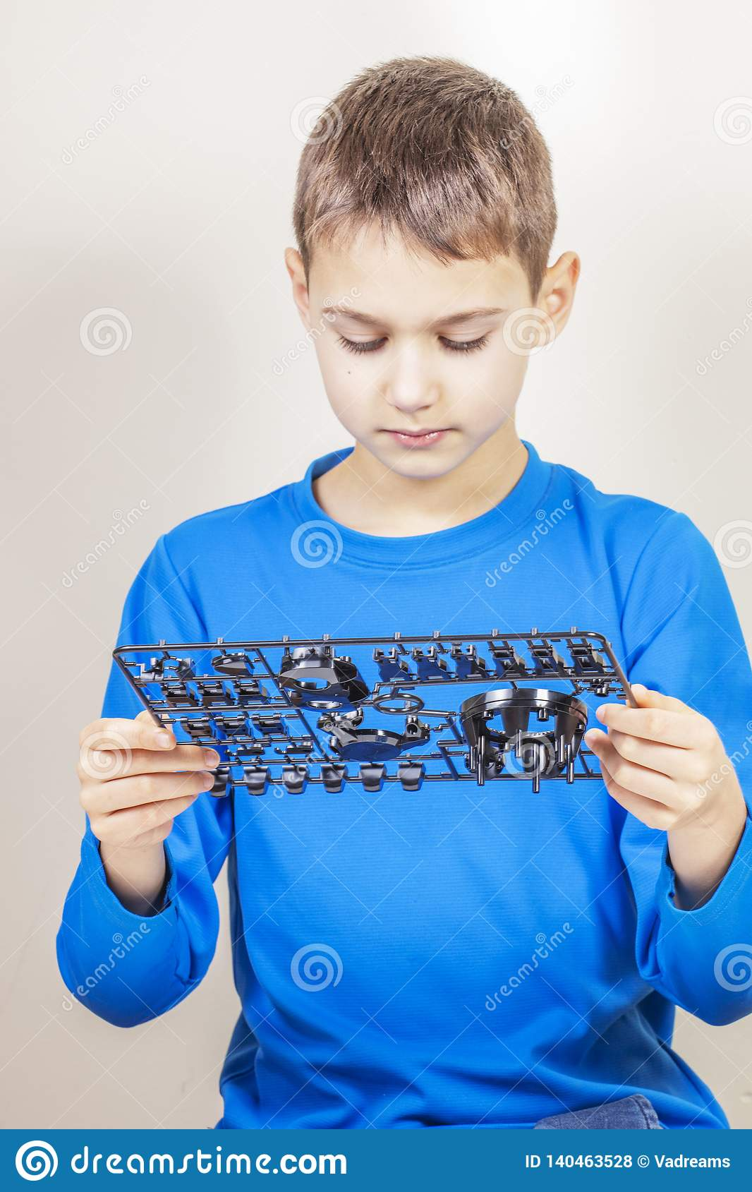 Child looking to new robot car details. Robotic, learning, technology, stem education for children background