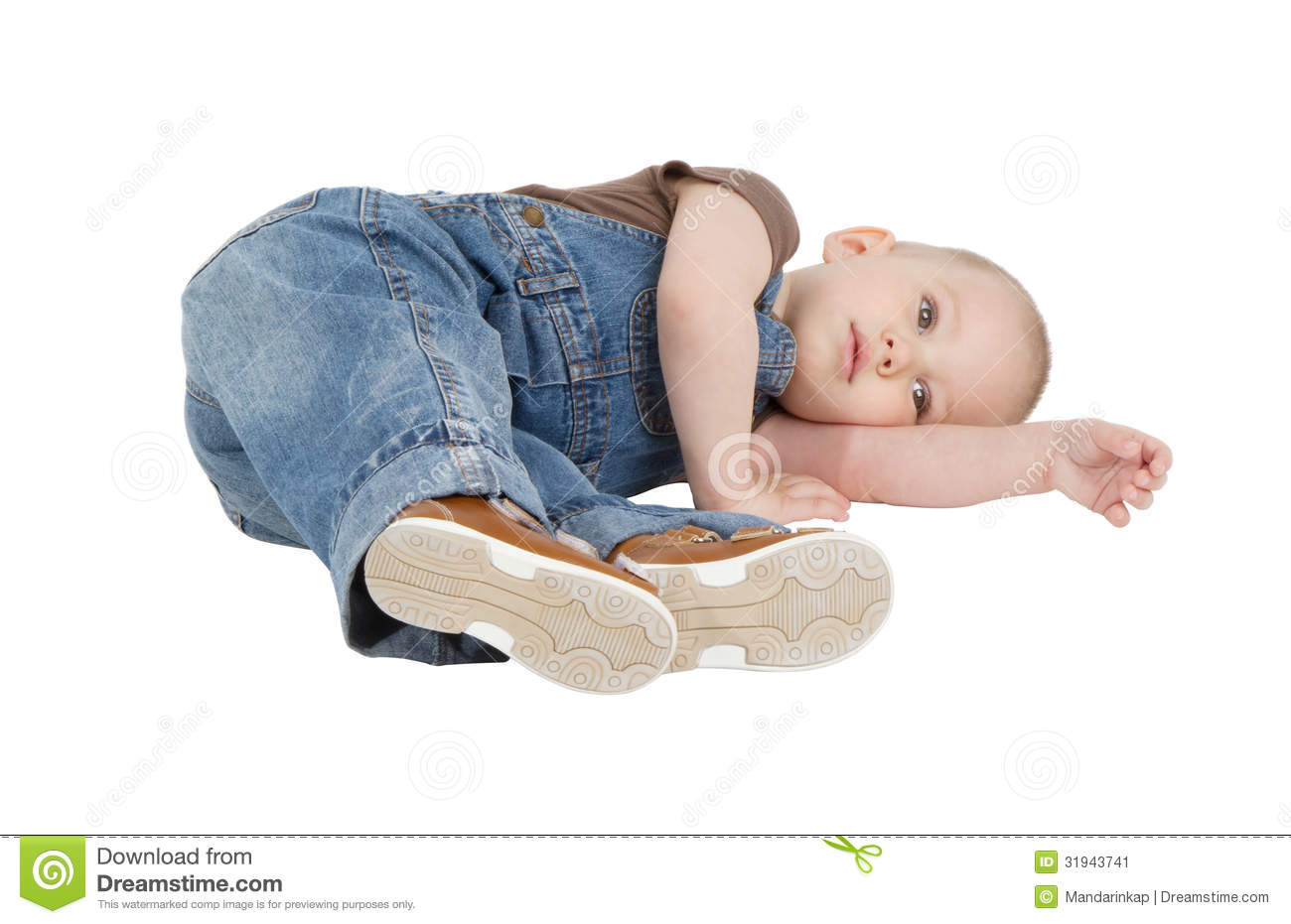 Child Is Lying On The Floor Stock Image - Image: 31943741