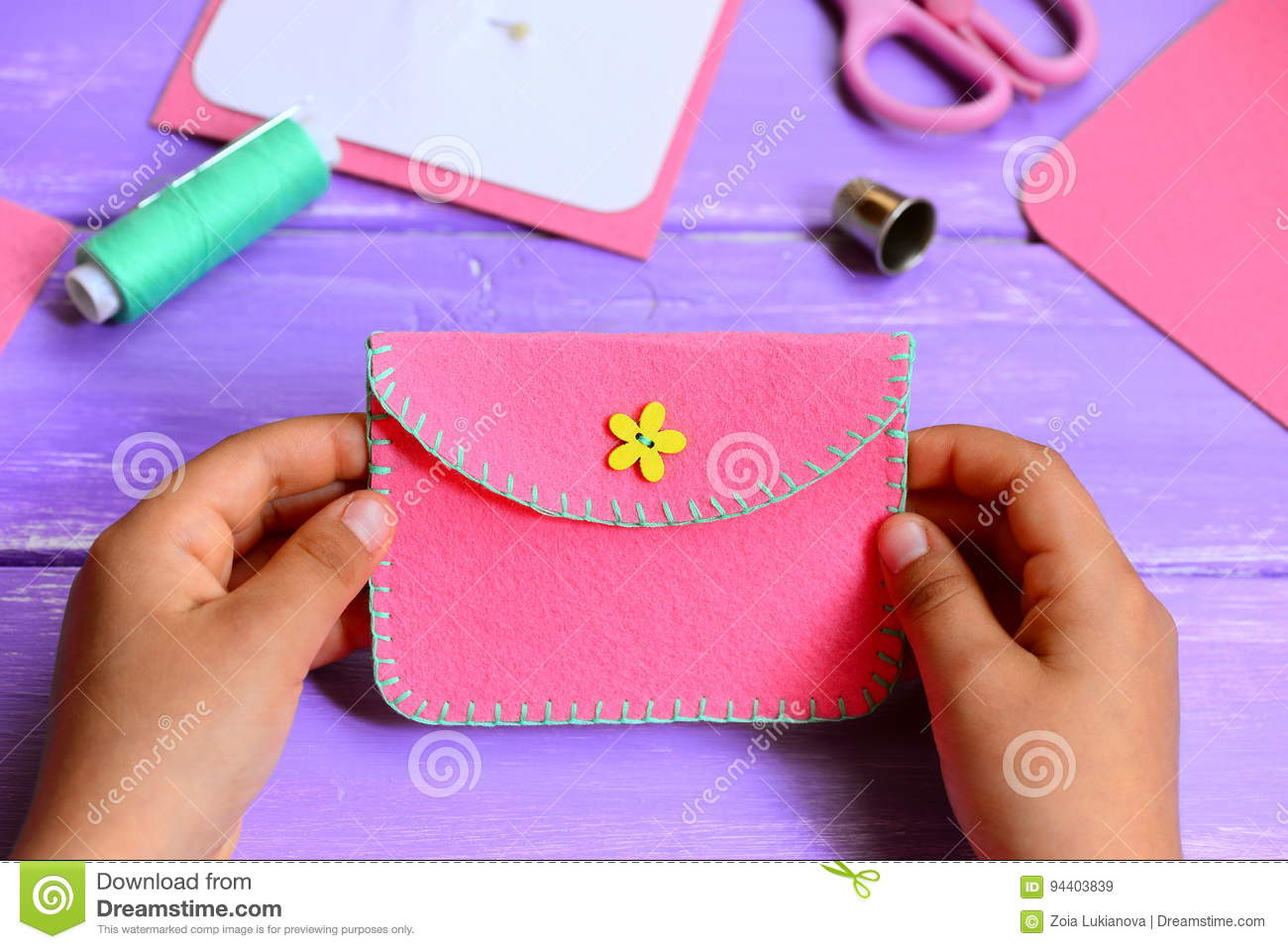 Child Made A Felt Purse Small Child Holds A Pink Felt Purse In His