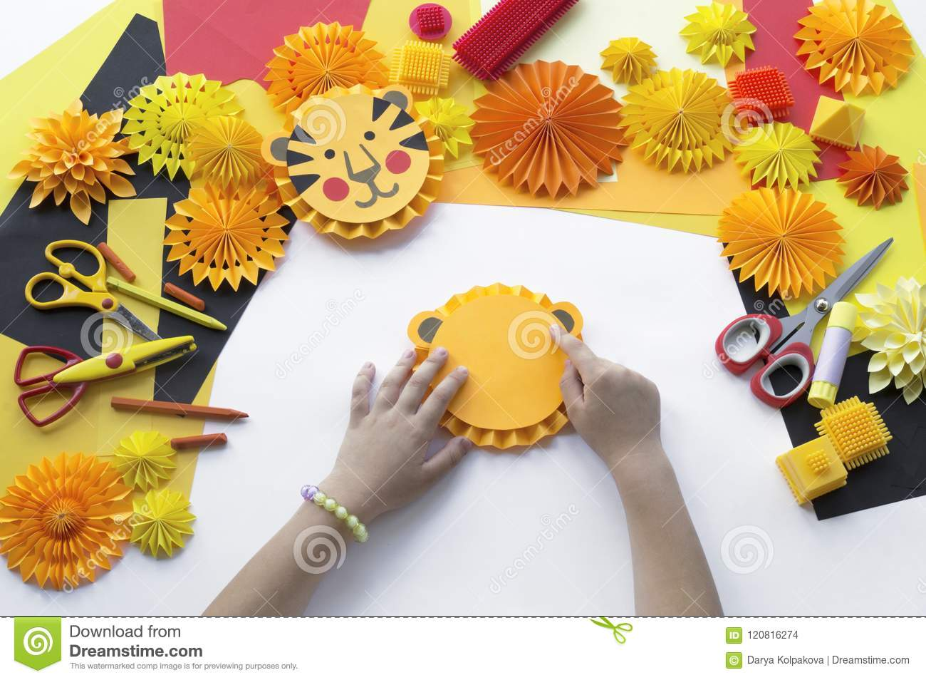 The Child Makes A Hand Made Paper Tiger Origami Stock Photo