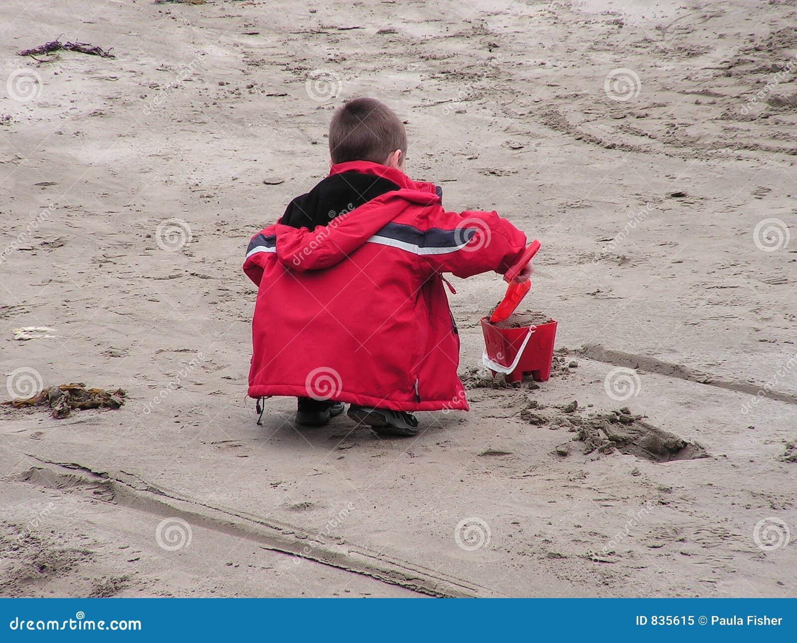 Child making sand castles