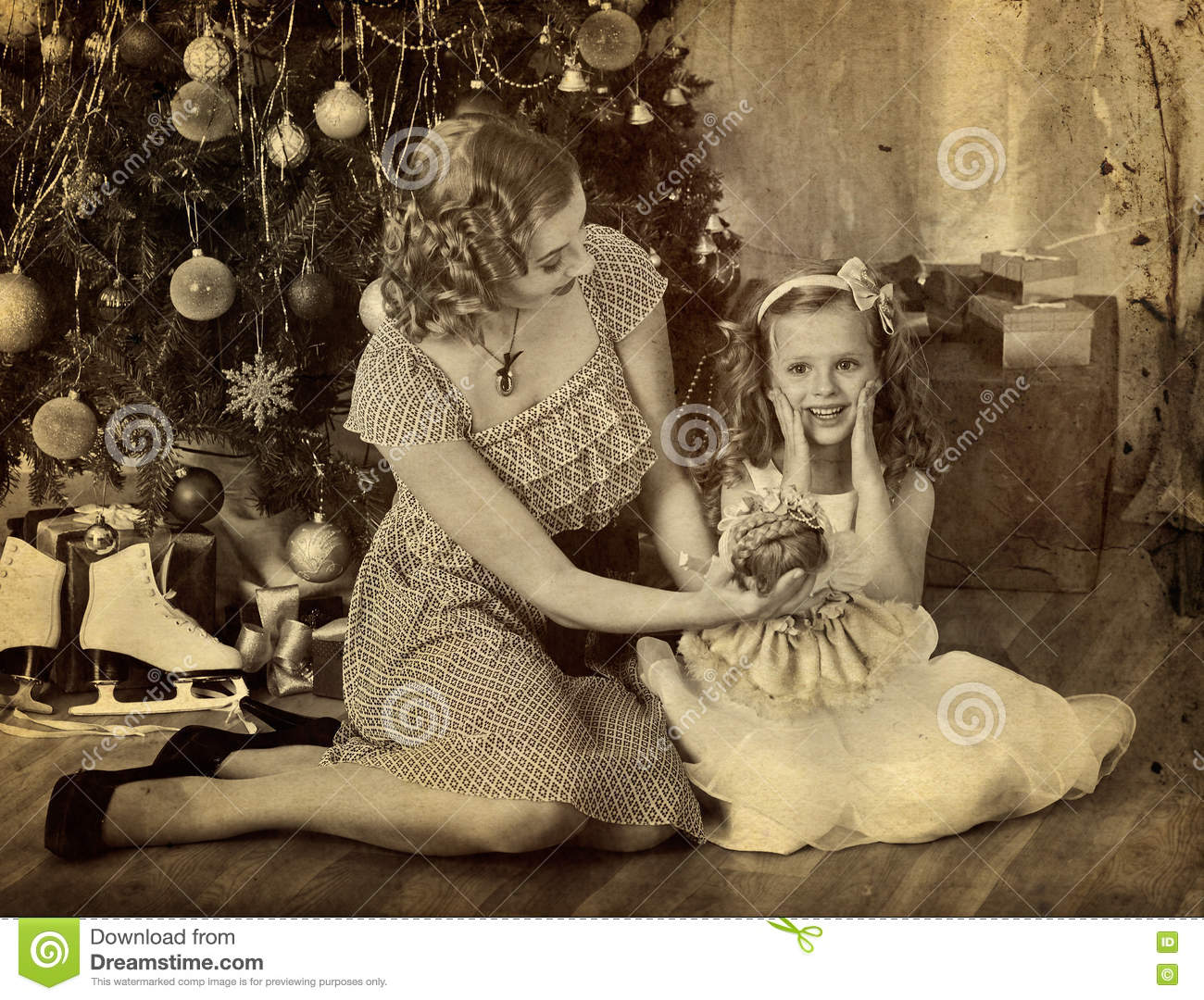 Child With Mother And Doll Near Christmas Tree. Stock Photo - Image ...