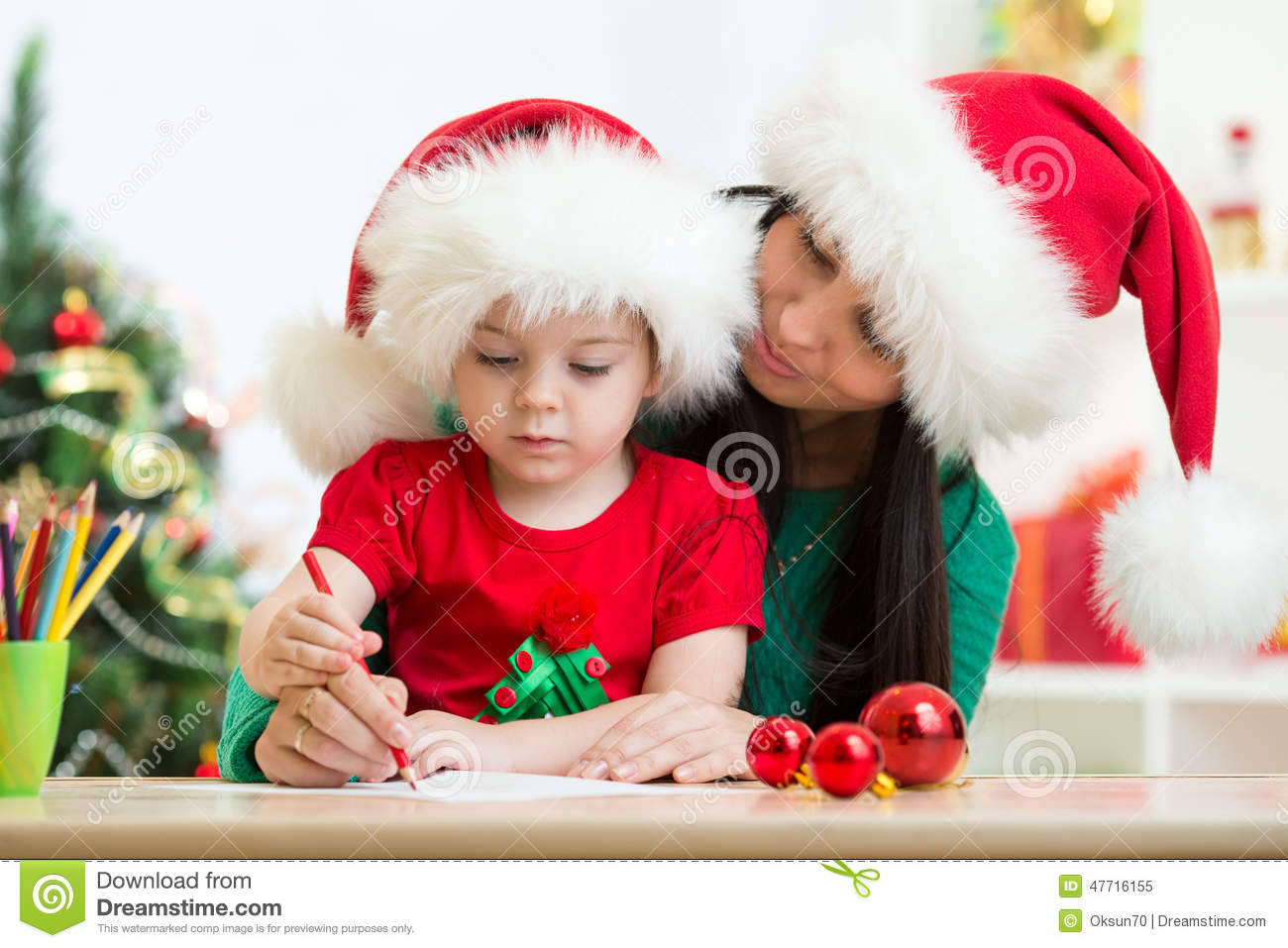 Child And Mother Writing Christmas Letter To Santa Claus Stock Image