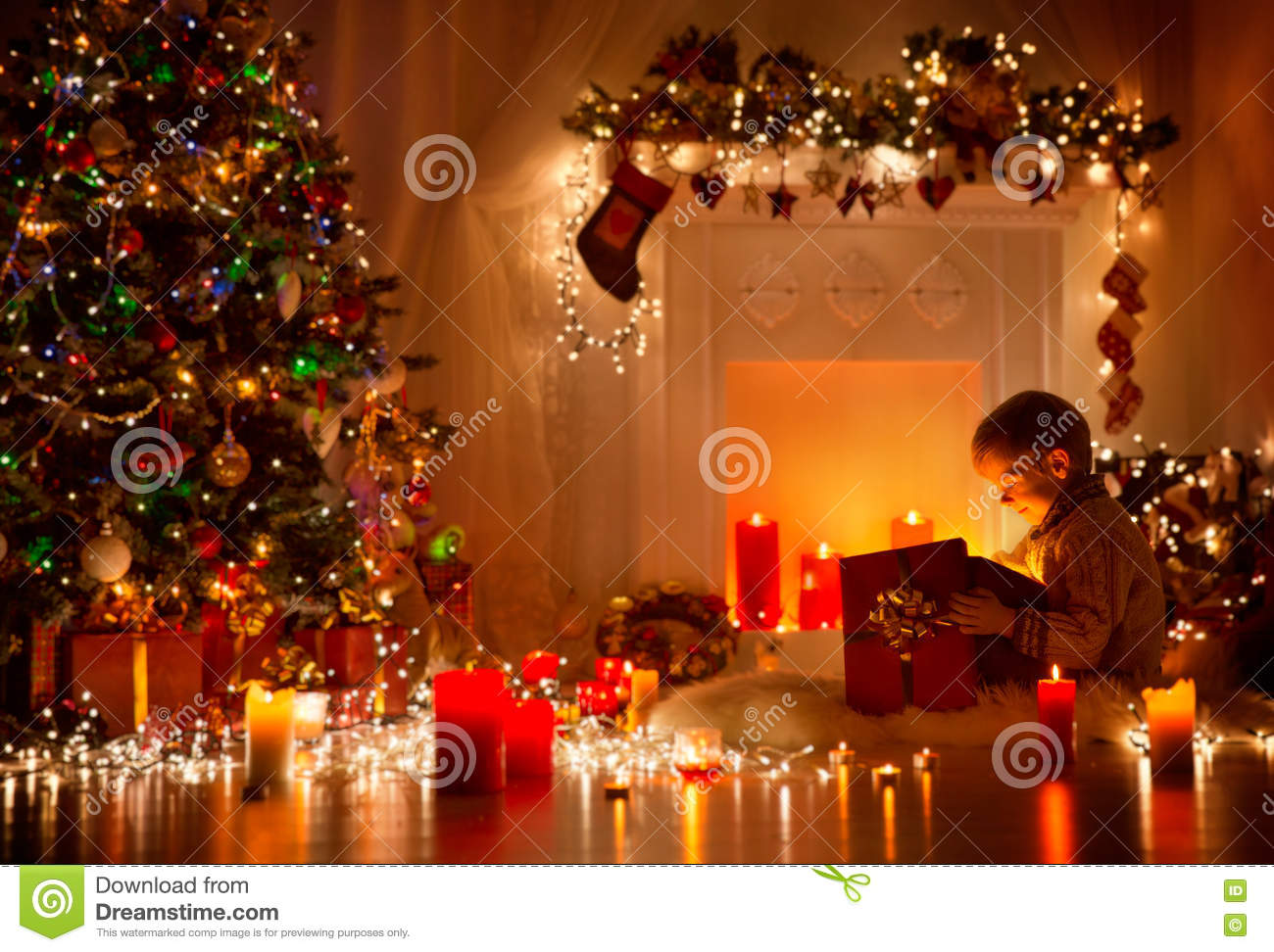 Child Opening Christmas Present, Kid Looking To Light Gift Box Stock ...