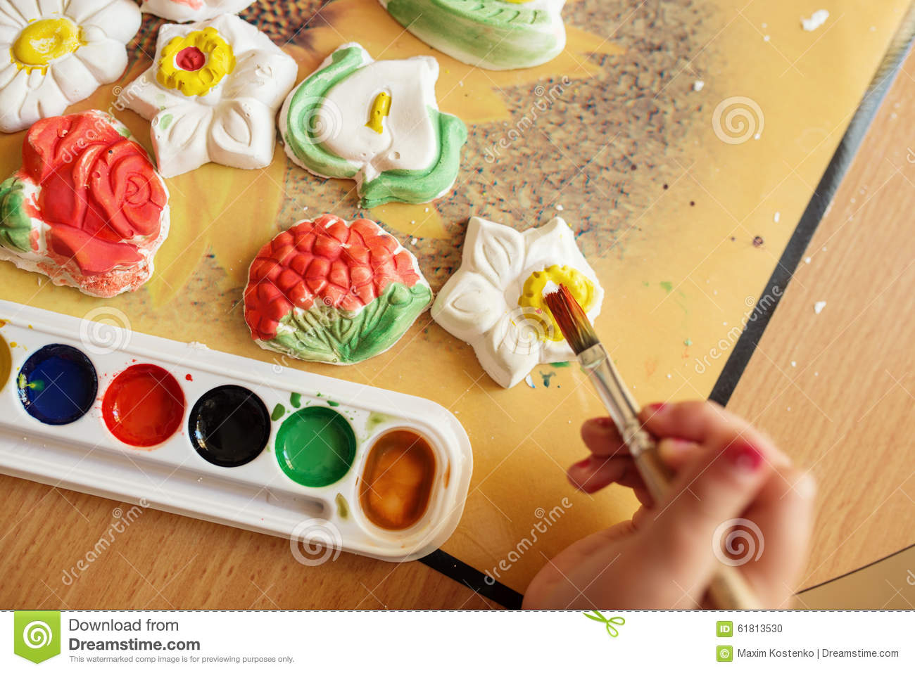Child Painting A Ceramic Pottery Stock Photo - Image of