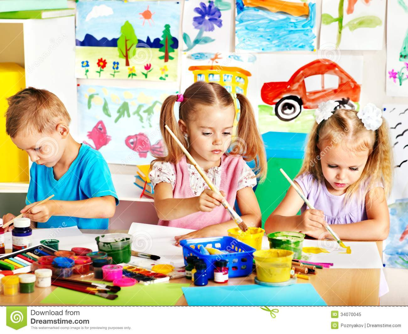child painting at easel - Children Painting Images