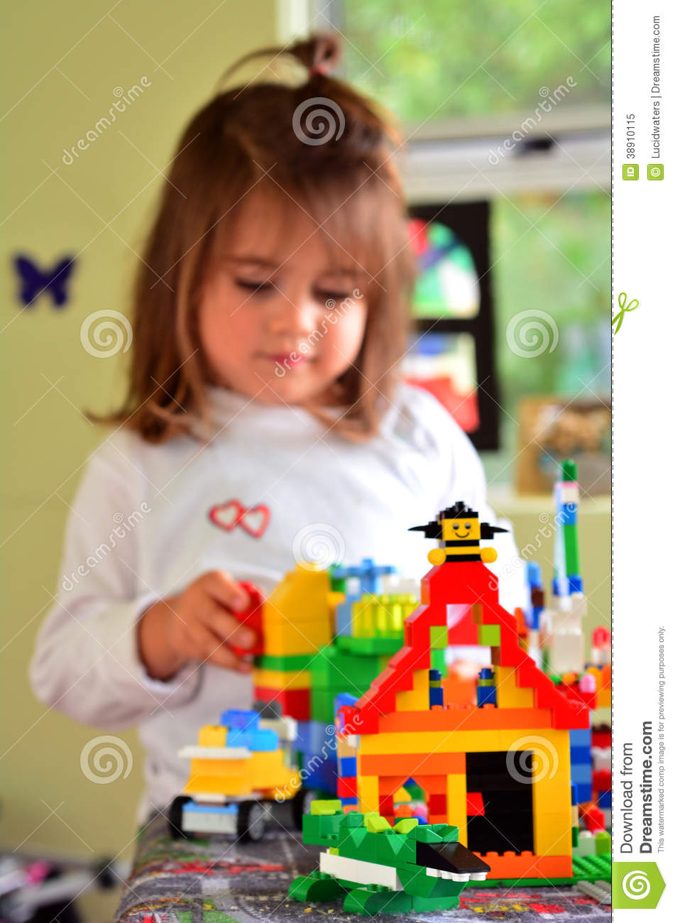 Play With Patterns Prints And Lots Of Accessories For: Child Play With Lego Construction Toy Editorial Image