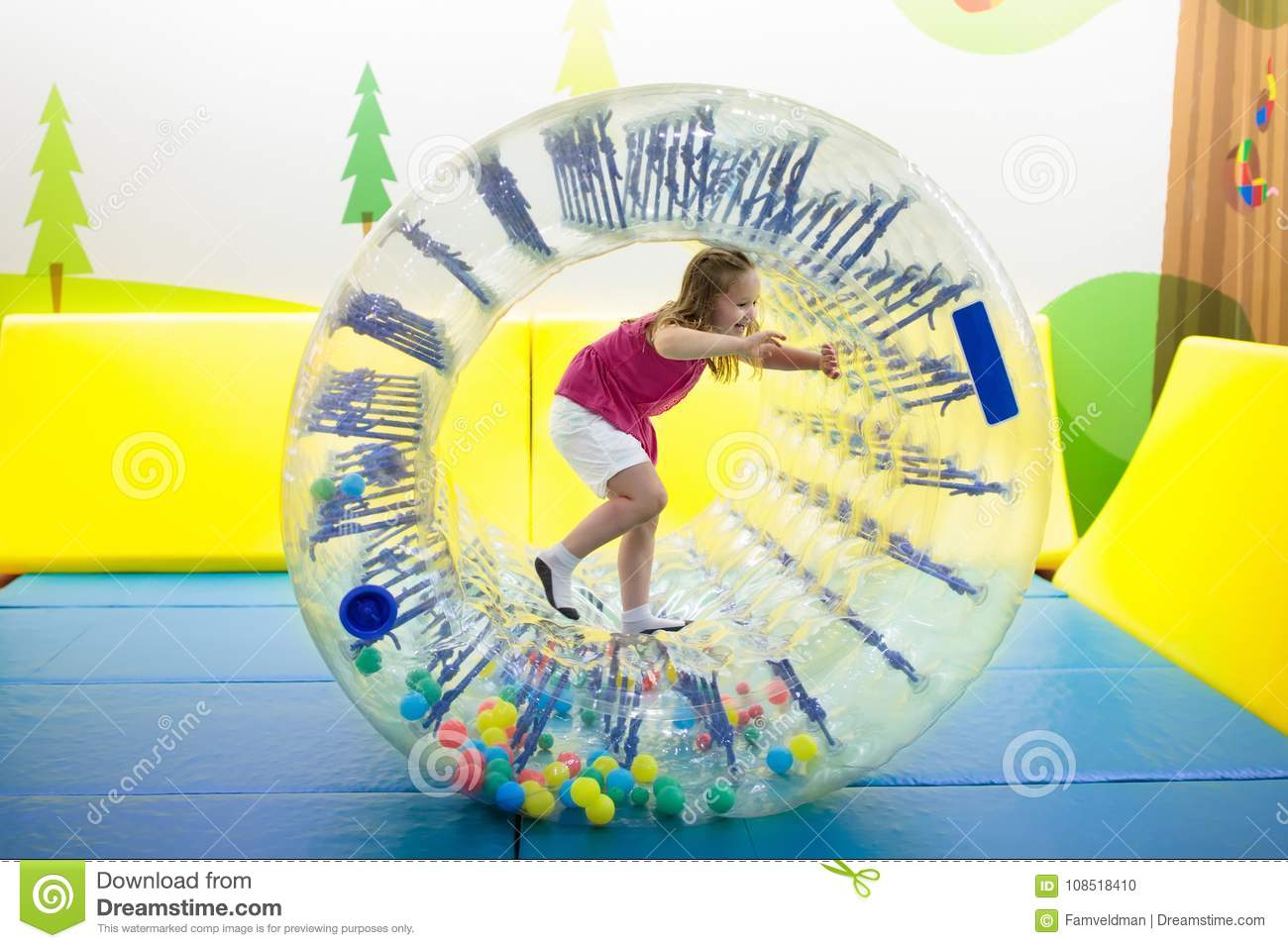 26e5f4026 Child Play In Roller Wheel. Kids On Trampoline. Stock Photo - Image ...