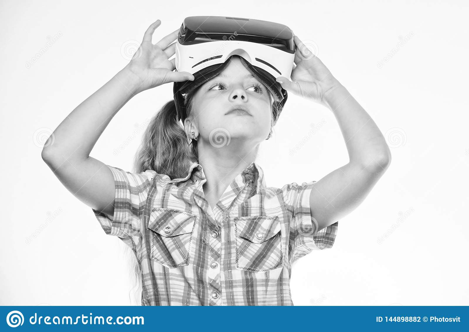 Child play virtual games with modern device. Explore virtual opportunity. Newest kids virtual reality games. Virtual