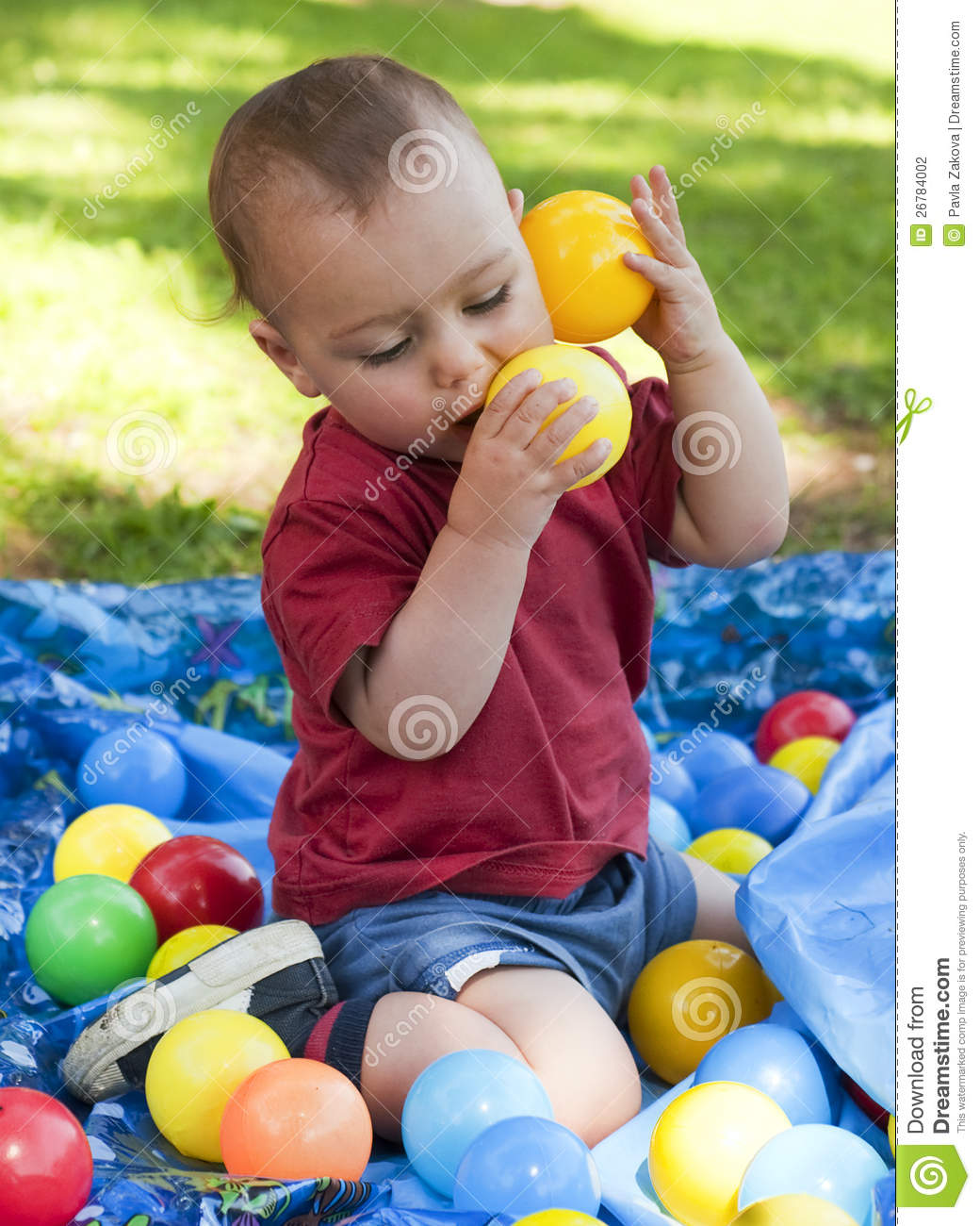 child playing with balls in garden stock photo image 26784002. Black Bedroom Furniture Sets. Home Design Ideas