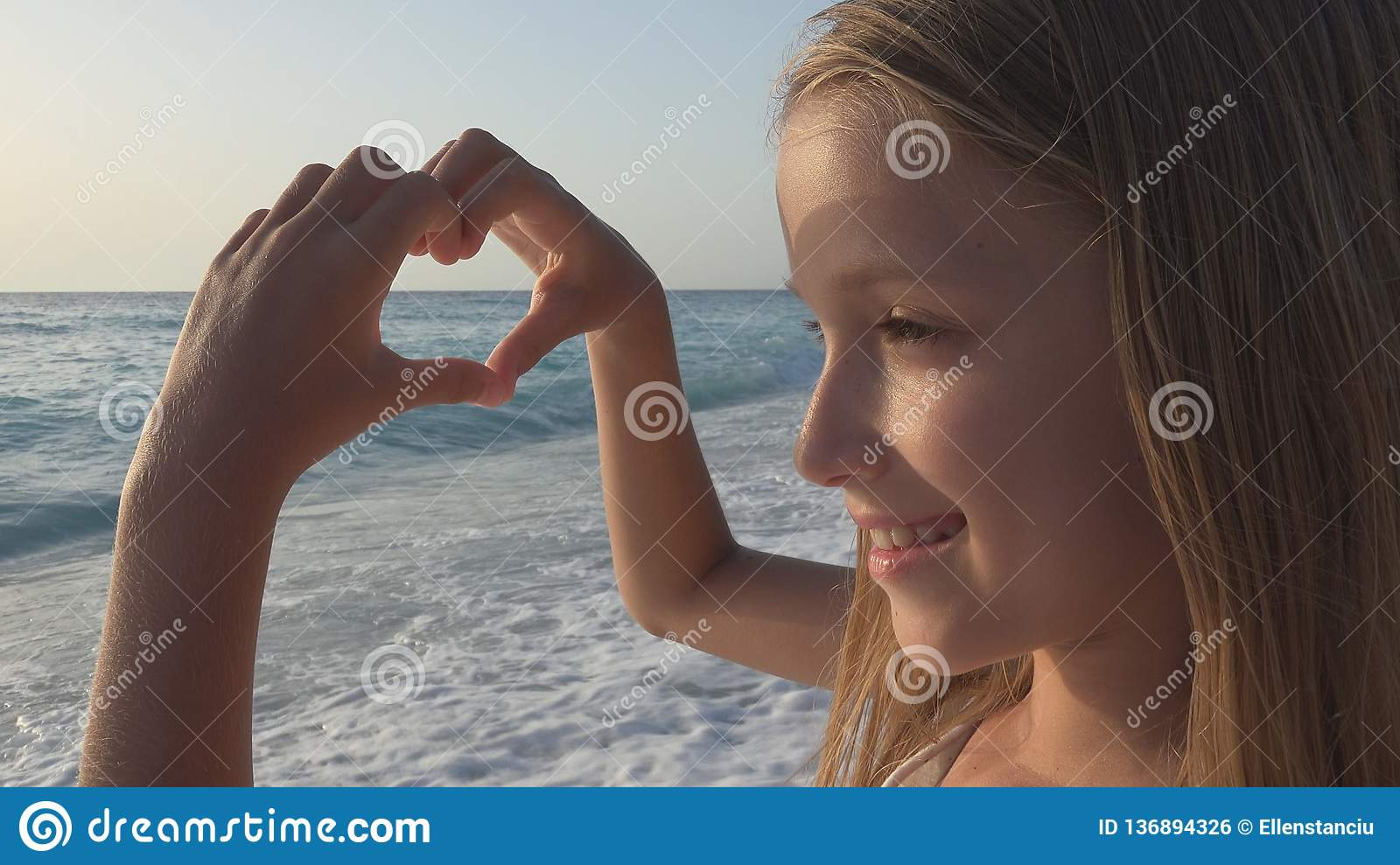 Child Playing on Beach, Kid Watching Sea Waves, Girl Makes Heart Shape Love Sign