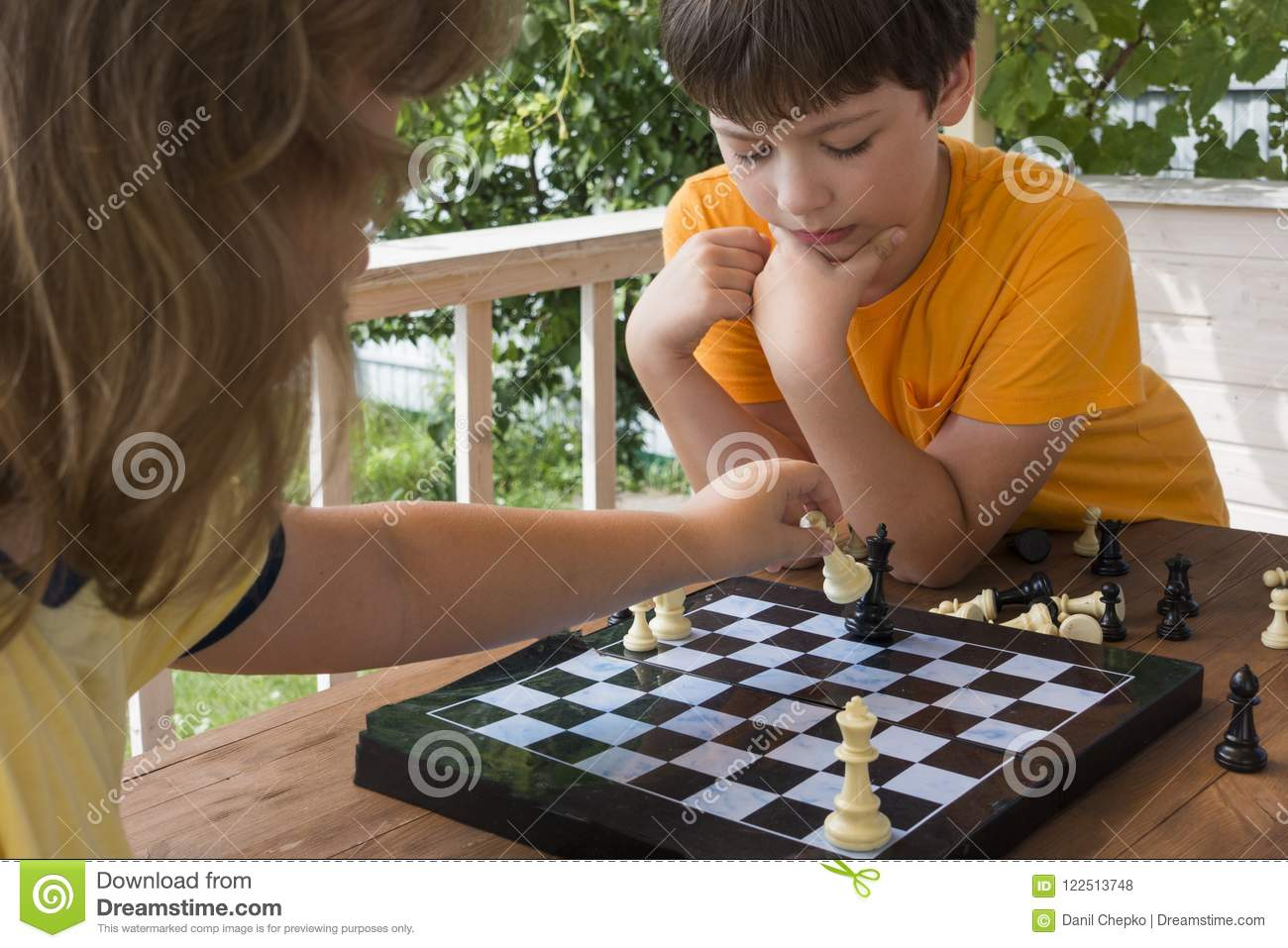 Download Child Playing Chess Outdors, Young Boy Making A Move Stock Photo - Image of hand, learning: 122513748