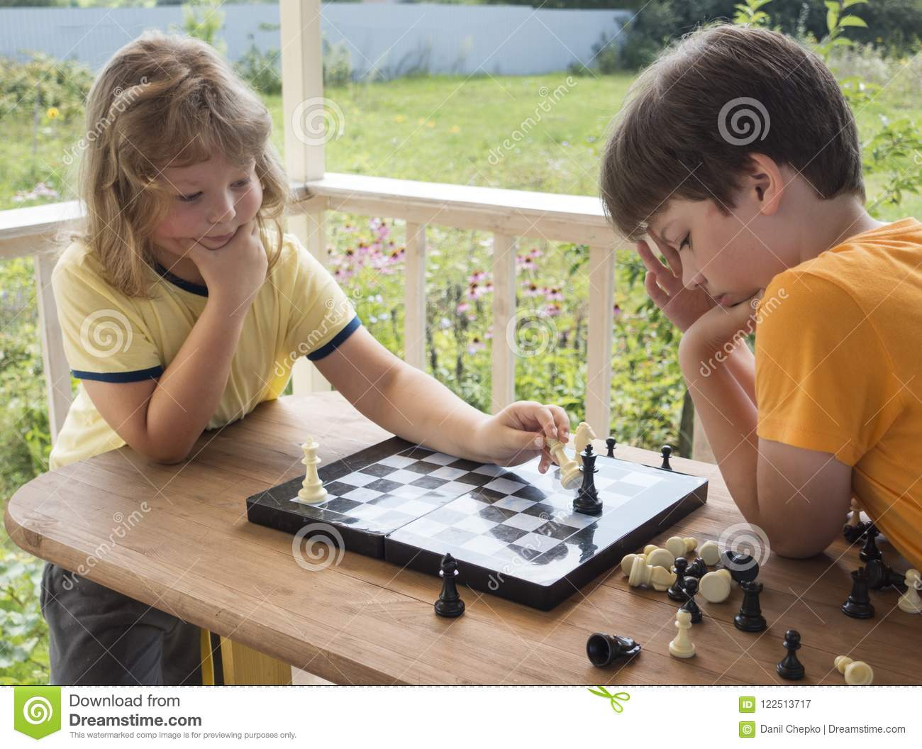 Download Child Playing Chess Outdors, Young Boy Making A Move Stock Image - Image of caucasian, learn: 122513717