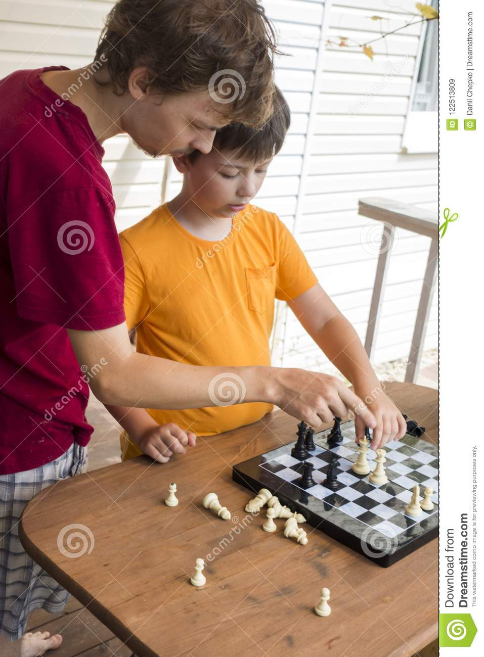 Download Child Playing Chess Outdors, Young Boy Making A Move Stock Image - Image of concentration, caucasian: 122513809