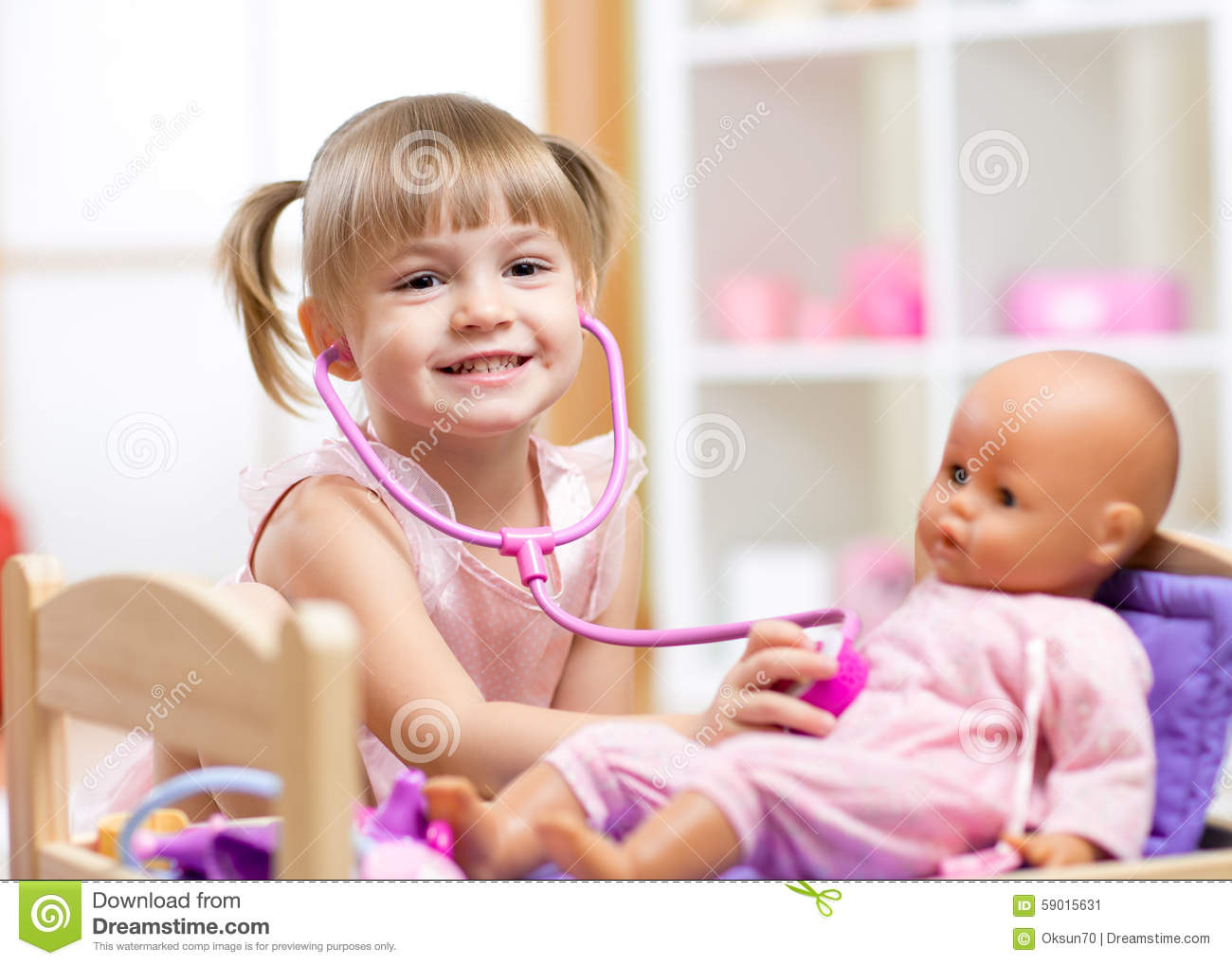 Child Playing Doctor Role Game Examinating Her Stock Photo