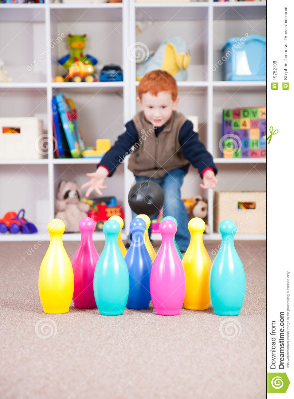 Child Playing Game With Kids Bowling Skittles Royalty Free
