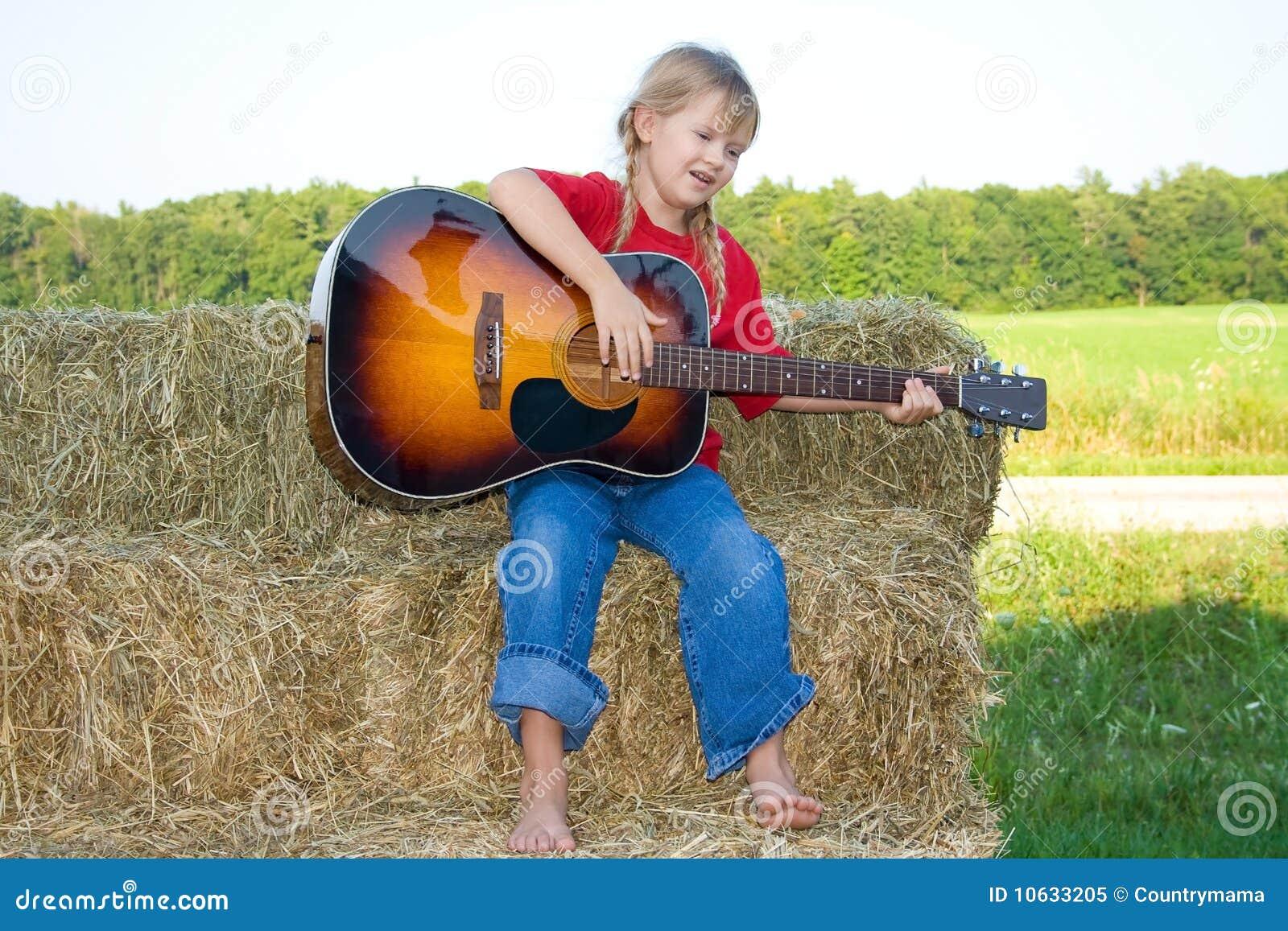 Child playing instrument.