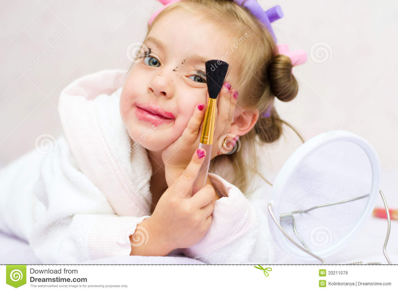 Child Playing With Makeup Royalty Free Stock Images - Image: 33211079