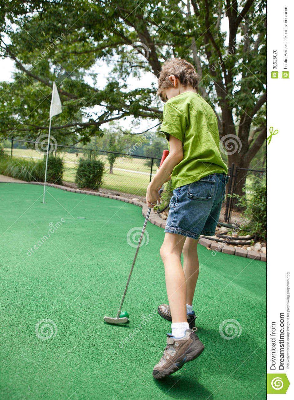 child playing miniature golf stock photo image 30625070. Black Bedroom Furniture Sets. Home Design Ideas
