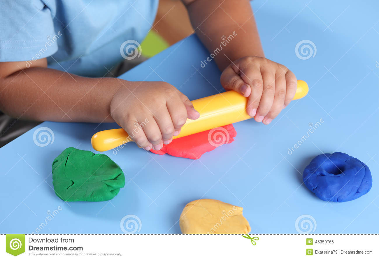 Child Playing With Modeling Clay Stock Photo - Image: 45350766