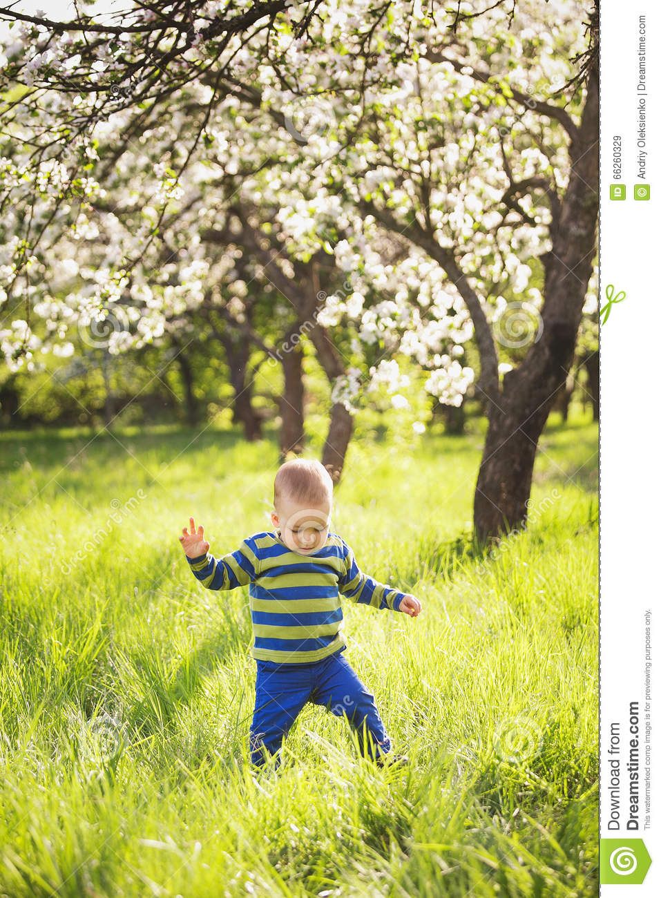 Child playing outside on spring warm sunny day