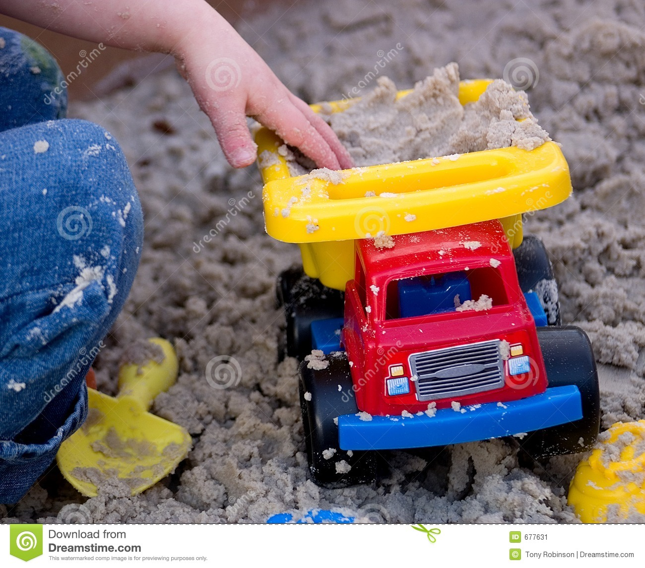 Child Playing With Plastic Truck In Sand Stock Image Image 677631