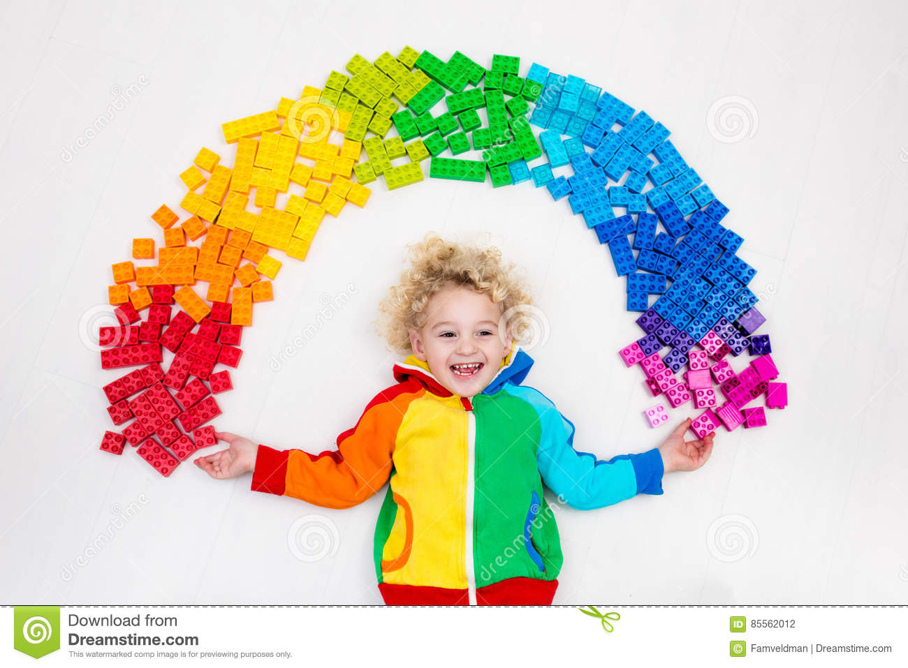 233d68d814bf Child Playing With Rainbow Plastic Blocks Toy Stock Photo - Image of ...